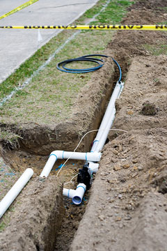 underground sprinkler pipe and trench